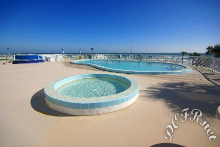 Pool Deck with Kiddy Pool, Large Lagoon Pool, & Hot Tub